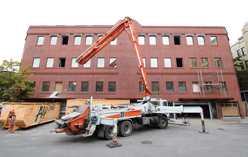 Vacant Old Town office building re-envisioned as rental apartments, commercial space